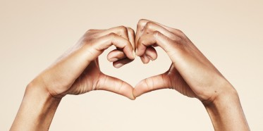 Hands forming a cute heart shape