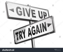 stock-photo-try-again-give-up-keep-going-and-trying-self-belief-never-stop-believing-in-yourself-road-sign-dont-301457174